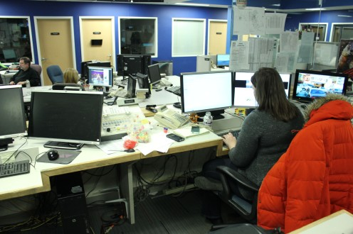 The assignment desk at WBZ-TV has several work stations and overlooks the newsroom.